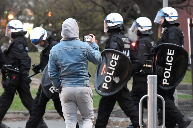 Cinq personnes ont été arrêtées au cours d'une manifestation pour la Journée... (PHOTO BERNARD BRAULT, LA PRESSE)
