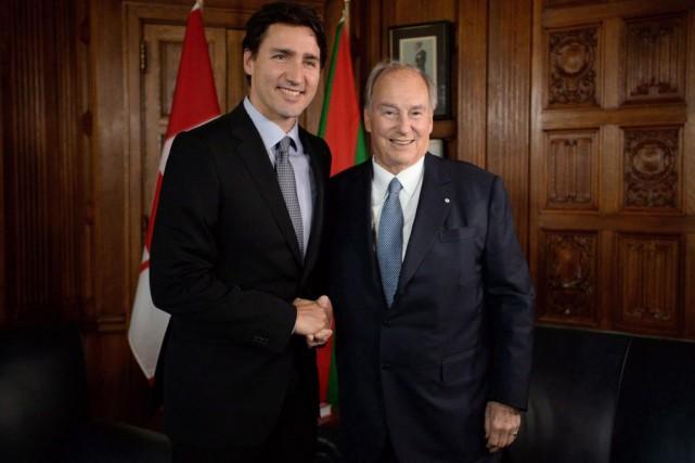 JustinTrudeau,premier ministre du Canada (à gauche), en compagnie... (PHOTOSEANKILPATRICK, ARCHIVES LA PRESSE CANADIENNE)
