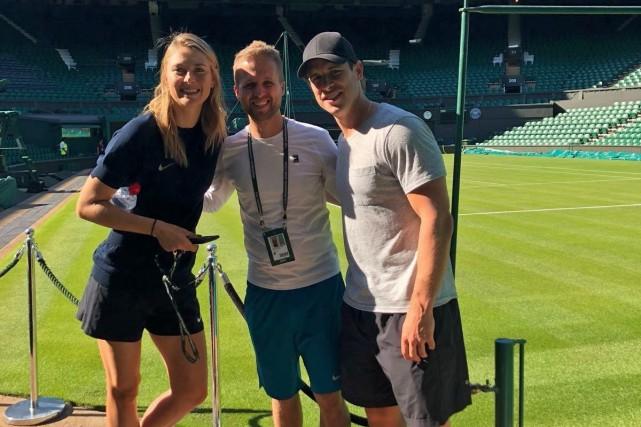 Marcin Goszczynski entouré de Maria Sharapova et de... (PHOTO PC)