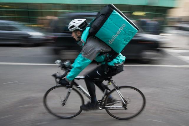 Créée en 2013, Deliveroo a connu une expansion... (PHOTO DANIEL LEAL-OLIVAS, ARCHIVES AGENCE FRANCE-PRESSE)