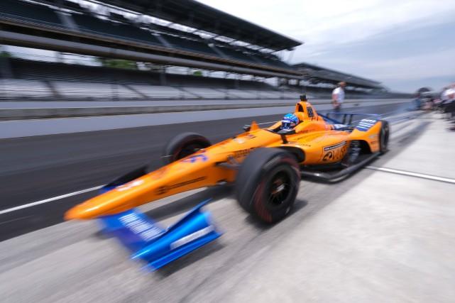 Fernando Alonso au volant de sa voiture.... (PHOTO AJ MAST, AP)