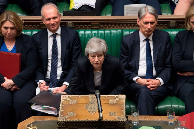 Face aux députés, mercredi, Theresa May a présenté... (PHOTO AFP)