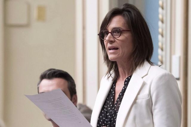 La ministre responsable de la Condition féminine, Isabelle... (PHOTO JACQUES BOISSINOT, ARCHIVES LA PRESSE CANADIENNE)