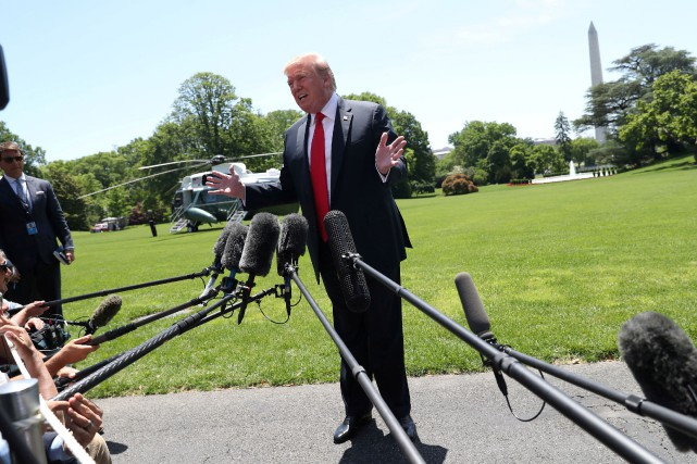 Donald Trump a répondu aux questions des journalistes... (PHOTO REUTERS)