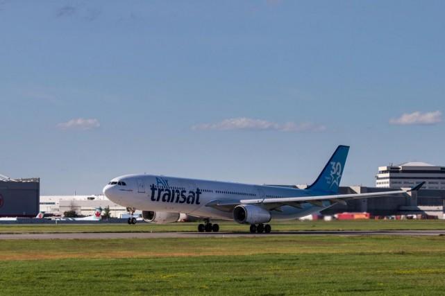La transaction entre Transat et Air Canada doit... (PHOTO HUGO-SÉBASTIEN AUBERT, ARCHIVES LA PRESSE)