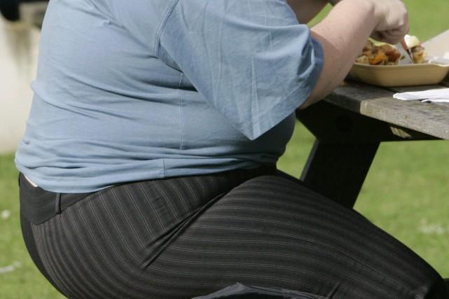 Le niveau d'obésité et le gain de poids... (PHOTO KIRSTY WIGGLESWORTH, ARCHIVES ASSOCIATED PRESS)
