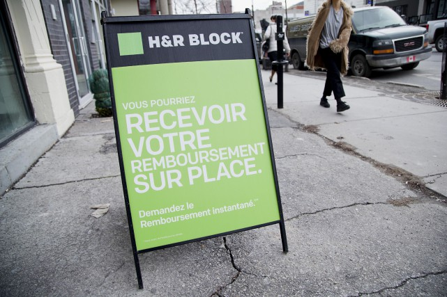 Selon les termes de l'accord, H&R Block mettra... (PHOTO ALAIN ROBERGE, LA PRESSE)