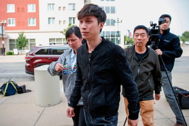 Le frère et les parents de de Yingying... (PHOTO AFP)