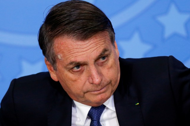 Le président brésilien Jair Bolsonaro... (PHOTO ADRIANO MACHADO, REUTERS)