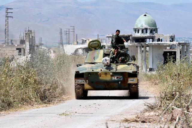 Un tank de l'armée syrienne.... (PHOTO GEORGE OURFALIAN, ARCHIVES AGENCE FRANCE-PRESSE)