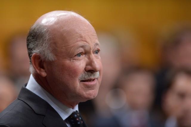 À son arrivée au parlement, le député libéral... (PHOTO SEAN KILPATRICK, ARCHIVES LA PRESSE CANADIENNE)
