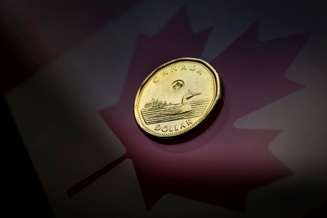 Le taux de change flottant du Canada a aidé son économie à s'adapter aux chocs... (PHOTO MARK BLINCH, ARCHIVES REUTERS)