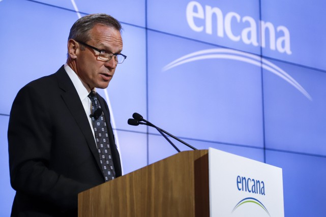Encana president and CEO Doug Suttles addresses the... (PHOTO JEFF MCINTOSH, THE CANADIAN PRESS)