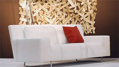 Ce canapé de forme impeccable est composé de...