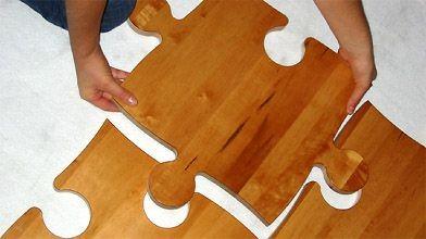 Le plancher de Puzzle Floor s'installe comme des...