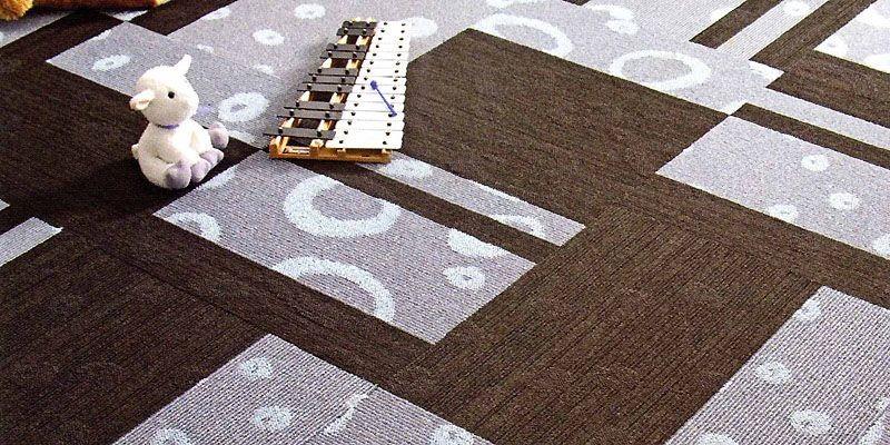Après des années d'exclusion, le tapis reprend du... (Photo tirée de <i>Je décore, planchers design</i>)