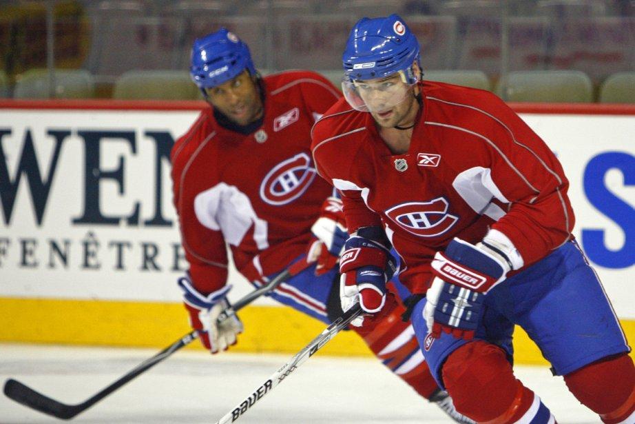 Chris Higgins et Georges Laraque... (Photo: Robert Mailloux, La Presse)