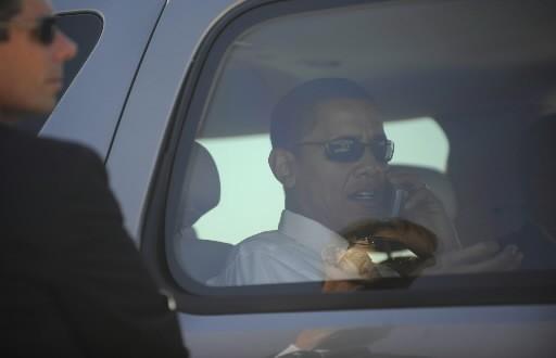 Un agent des services secrets surveille près de... (Photo: AFP)
