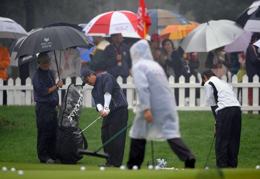 De fortes pluies se sont abattues vendredi sur le parcours du... (Photo: AFP)