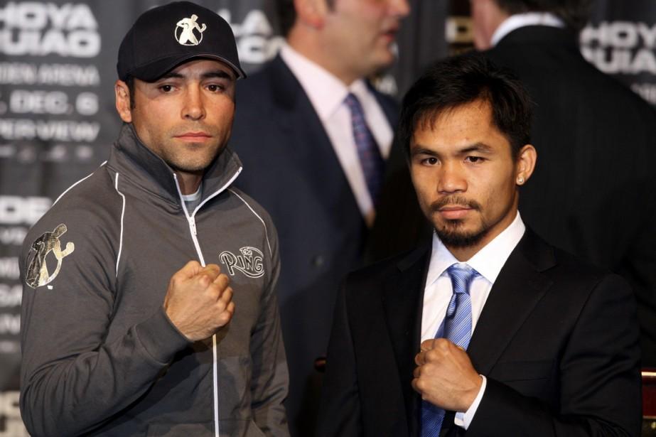 Oscar De La Hoya et Manny Pacquiao... (Photo: AP)