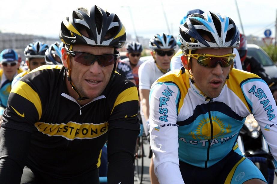 Lance Armstrong et Alberto Contador... (Photo: AFP)