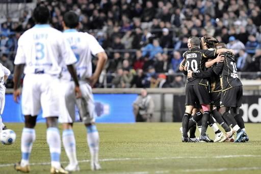 Les joueurs du Nancy célèbrent devant les Marseillais.... (Photo: AFP)