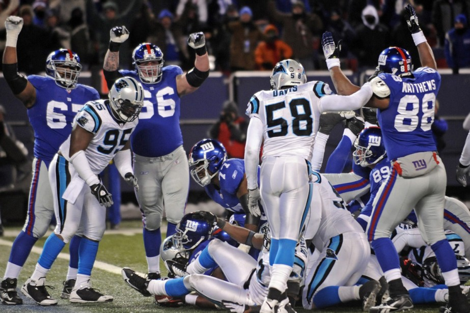 Brandon Jacobs a réussi trois touchés grâce à... (Photo: AP)