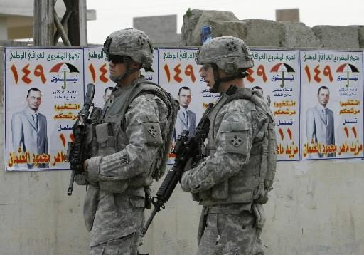 Des soldats américains montent la garde à Mossoul.... (Photo: Reuters)