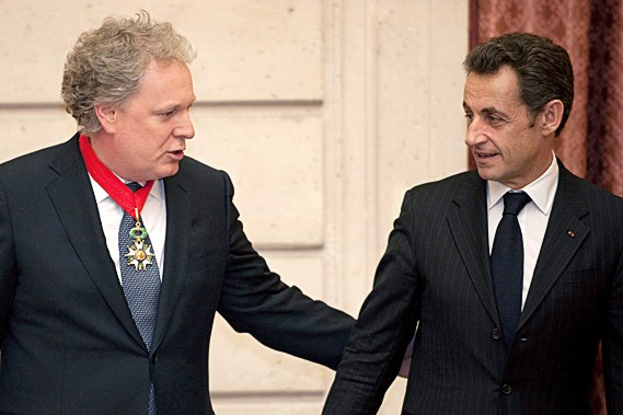 Jean Charest et Nicolas Sarkozy... (REUTERS)