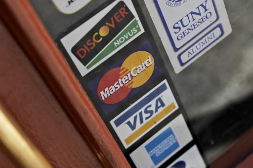 Les paiements électroniques ont contribué à près du quart -... (Photo: Bloomberg)