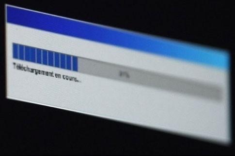 Quelque 78% des internautes chinois reconnaissent télécharger... (Photo: AFP)