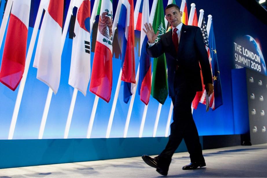 Le président américain Barack Obama quitte la conférence... (Photo: AFP)