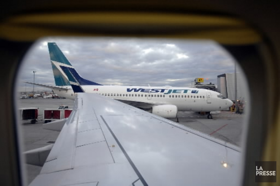 Les transporteurs WestJet ( (Photo: Bernard Brault, La Presse)