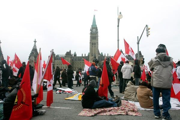 Le Canada a pressé dimanche les deux parties en... (Patrick Woodbury, LeDroit)