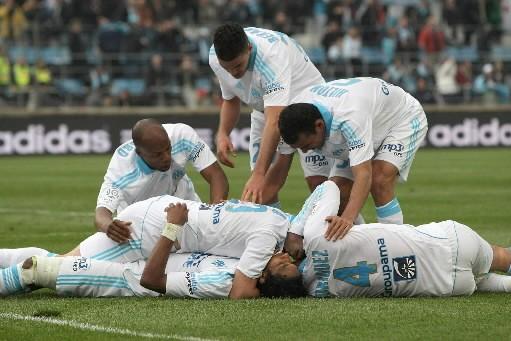 Les joueurs marseillais célèbrent leur victoire sur Grenoble.... (Photo: AP)