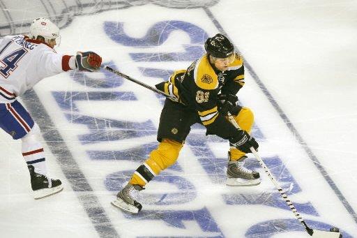 Patrice Bergeron ne s'attend pas à prendre d'assaut une... (Photo: Boston Globe)
