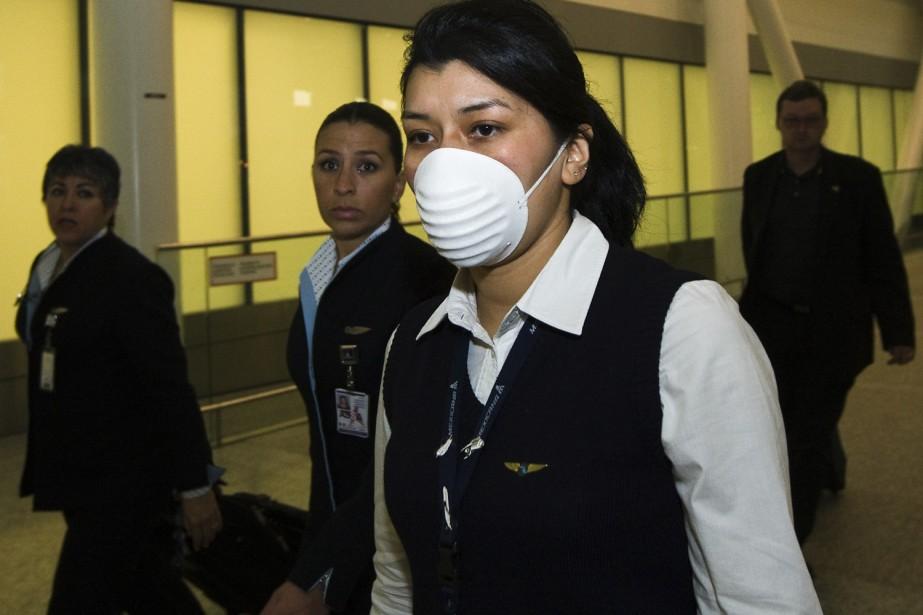 Une agente de bord arrivant de Mexico porte... (Photo: PC)