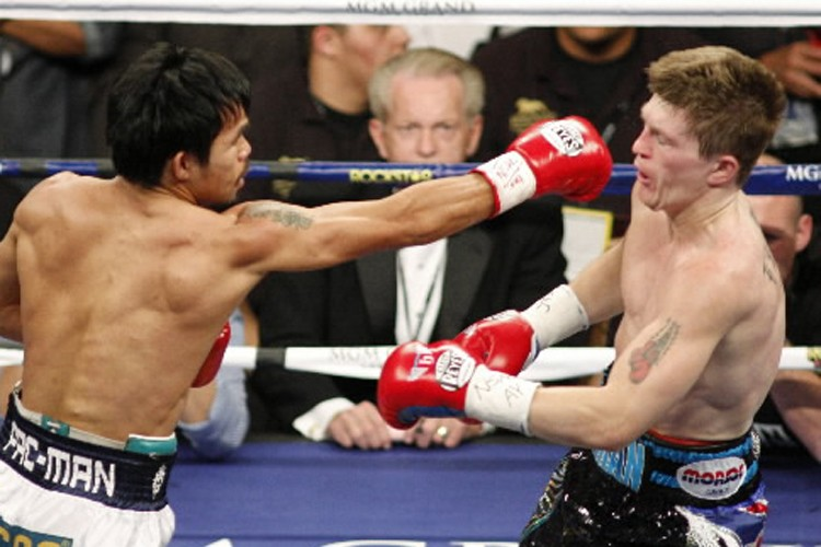 Manny Pacquiao a battu le Britannique Ricky Hatton.... (Photo Reuter)