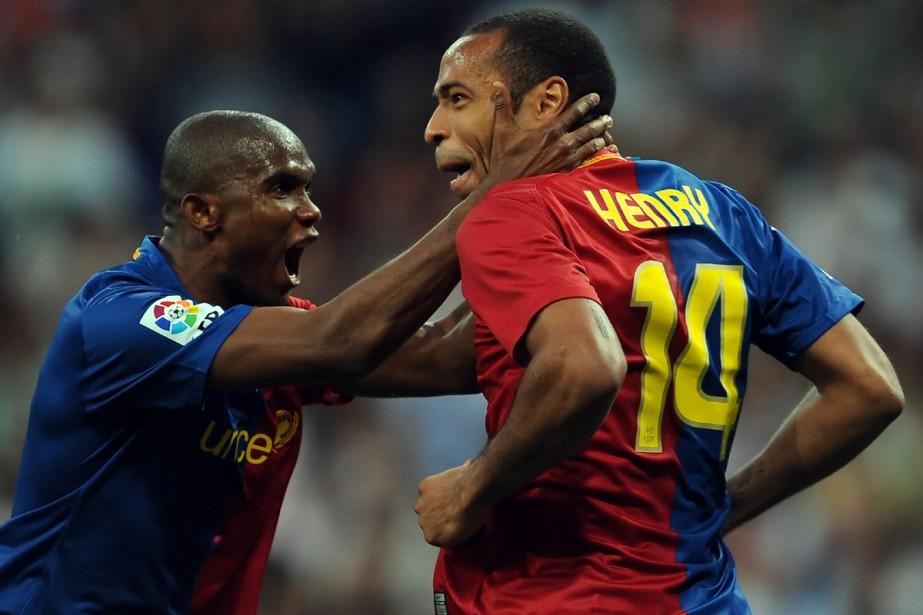 Samuel Eto'o et Thierry Henry... (Photo: AFP)
