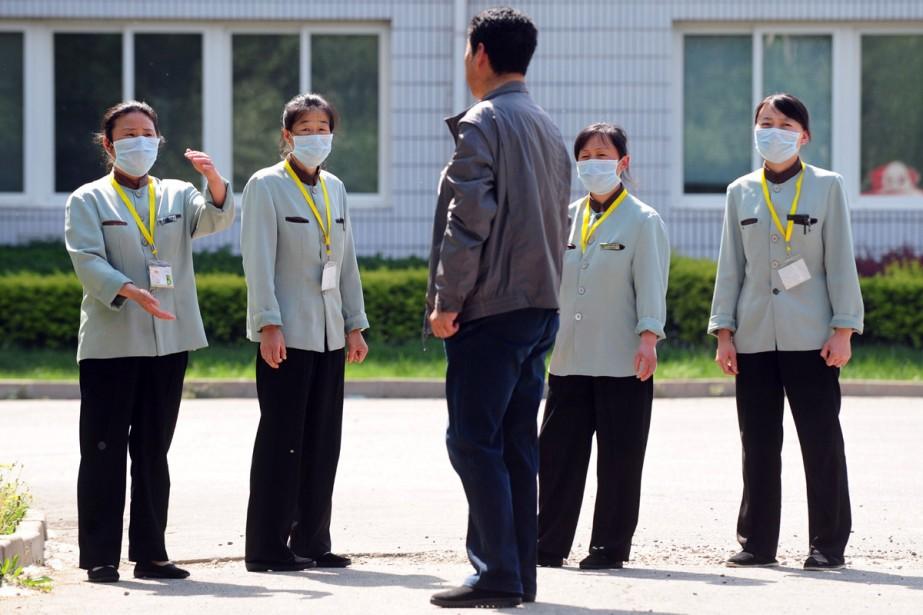 Deux groupes de Canadiens ont été placés en quarantaine dans des... (Photo AFP)