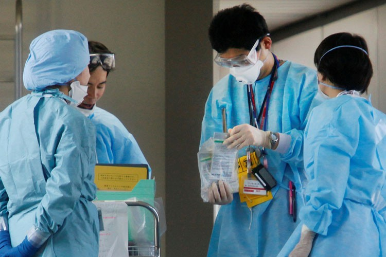 La progression du virus de la grippe A(H1N1)... (Photo: AP)