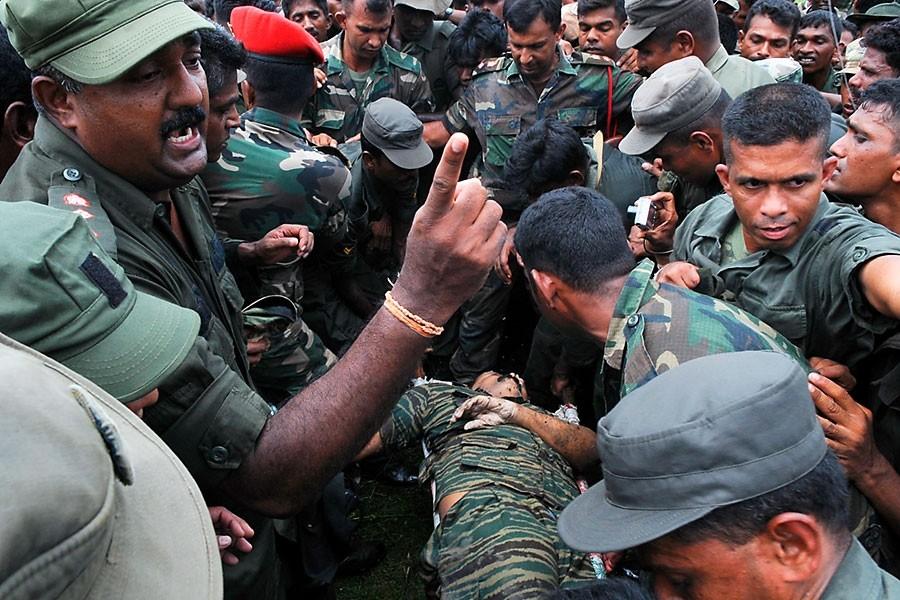 Les Tigres tamouls refusent d'authentifier la dépouille et... (Photo: Reuters)