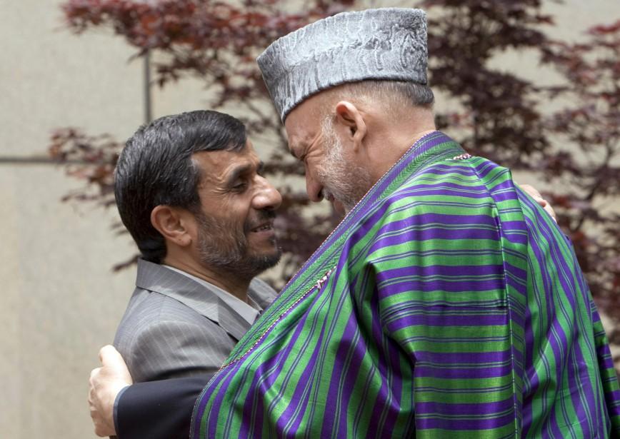 Mahmoud Ahmadinejad (à gauche) et Hamid Karzaï.... (Photo: Reuters)