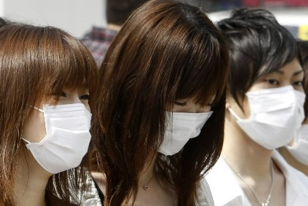 La grippe porcine continuait mardi sa lente progression dans... (Photo: Reuters)