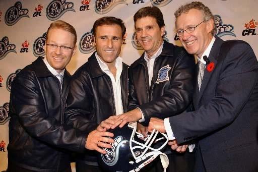 Les deux propriétaires des Argos, Howard Sokolowski et... (Photo Archives Presse Canadienne)