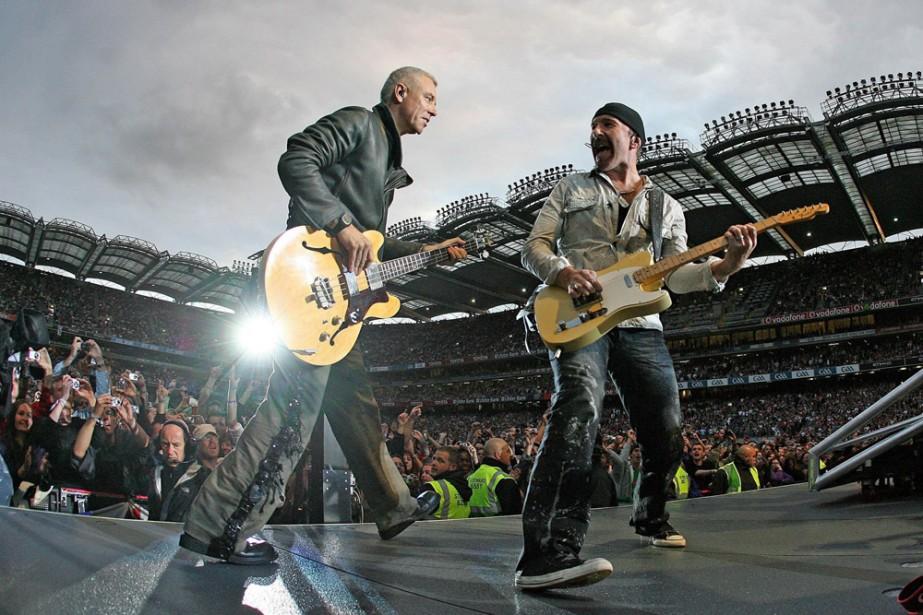 Adam Clayton et The Edge en spectacle à... (Photo: AP)