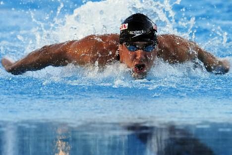 Michael Phelps lors du 100 m papillon au... (Photo Reuters)