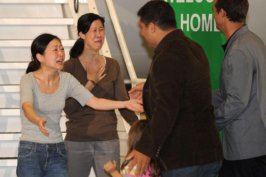 Retrouvailles émouvantes d'Euna Lee (à gauche) et Laura... (Photo AFP)