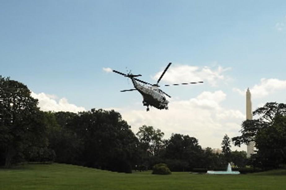 Barack Obama et sa famille se sont evolés... (Photo AFP)