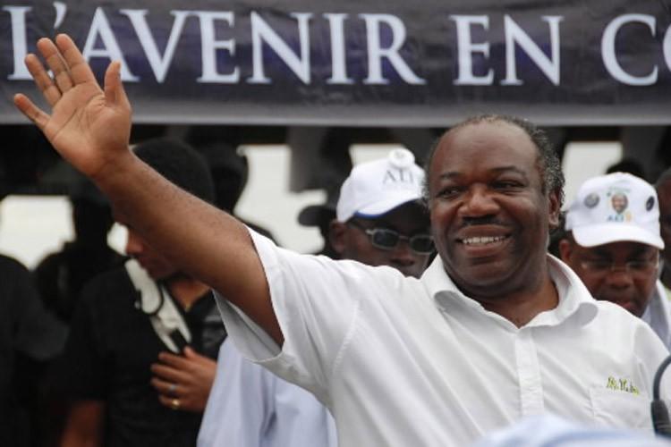 Ali Bongo, candidat du Parti démocratique gabonais et... (Photo: AP)